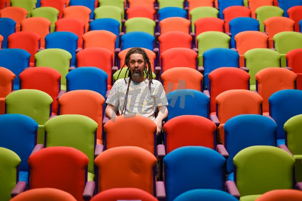 Single person sitting inside empty auditorium