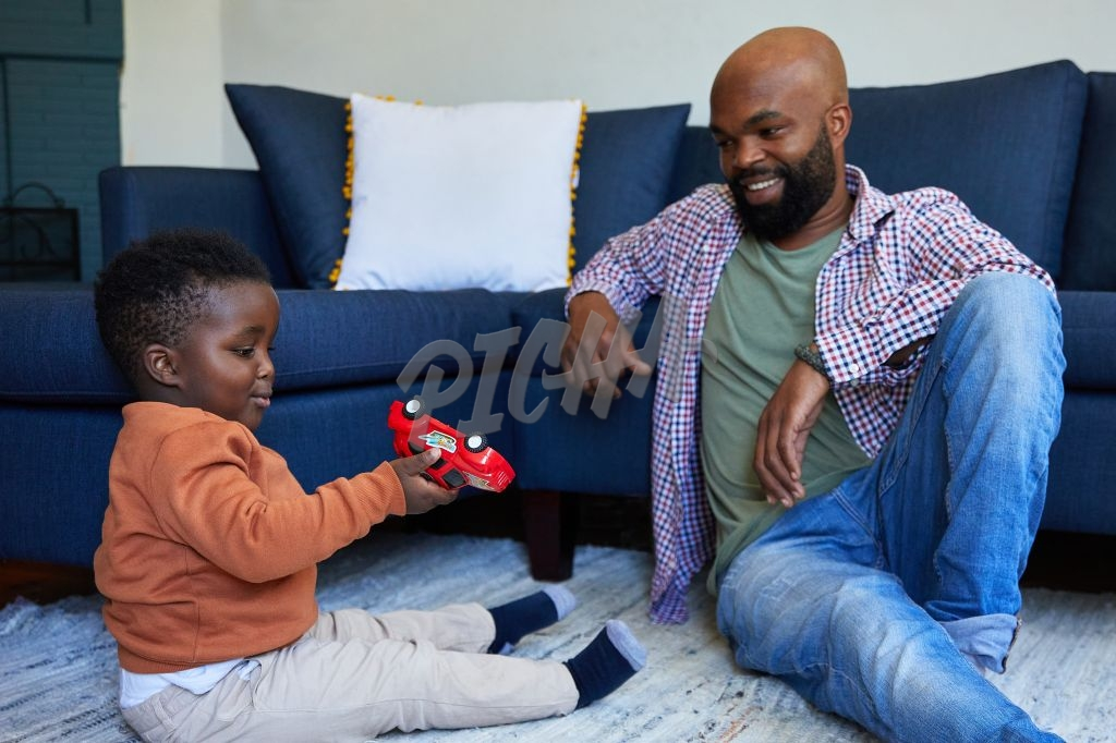 Father and son playing toy cars