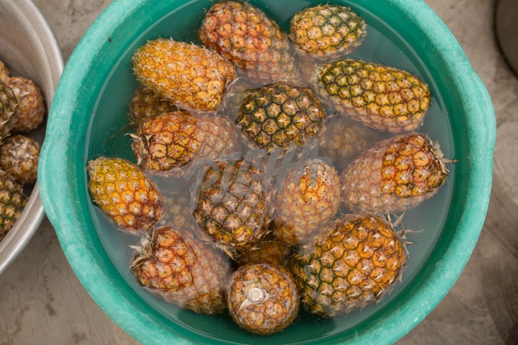 Pineapples in a bucket