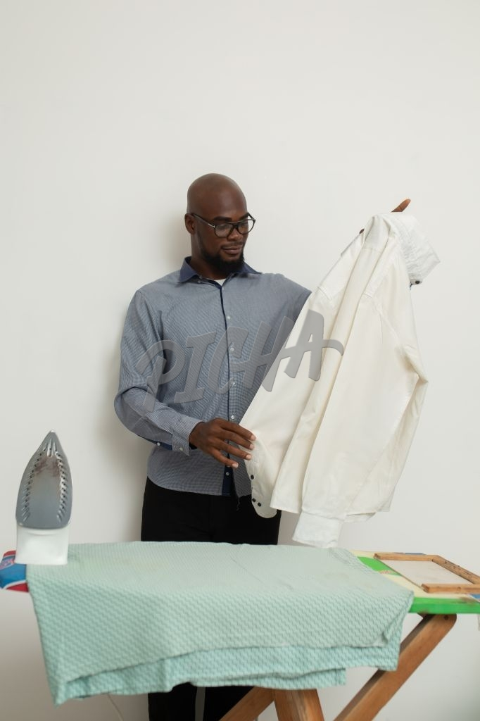 Man ironing a shirt
