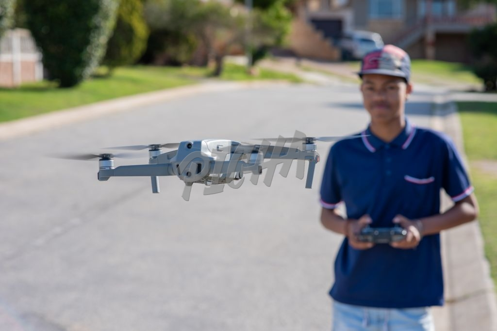 Young boy flying a drone outdoors