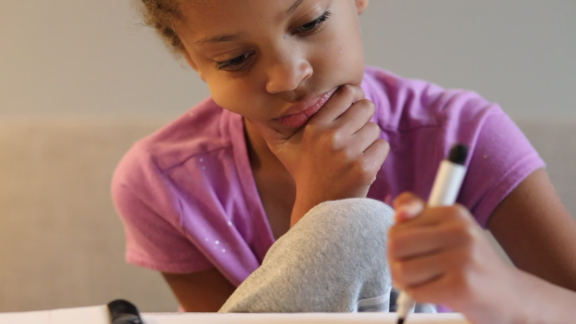 Girl writing with a marker pen