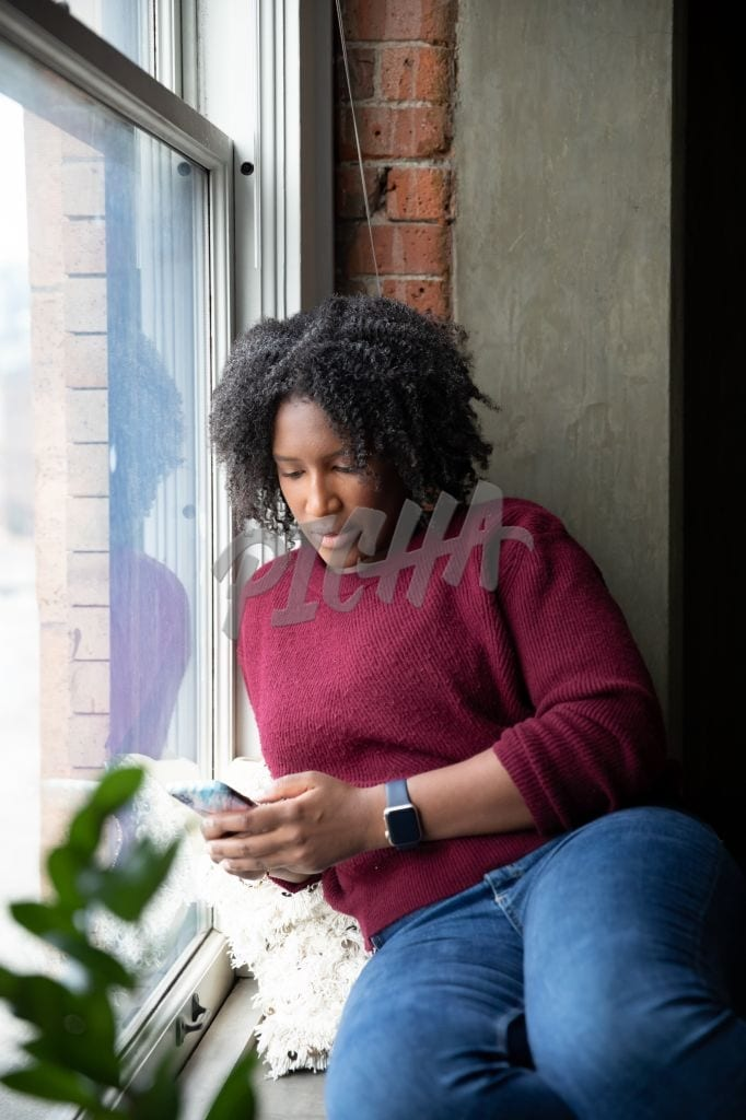 Texting by the window