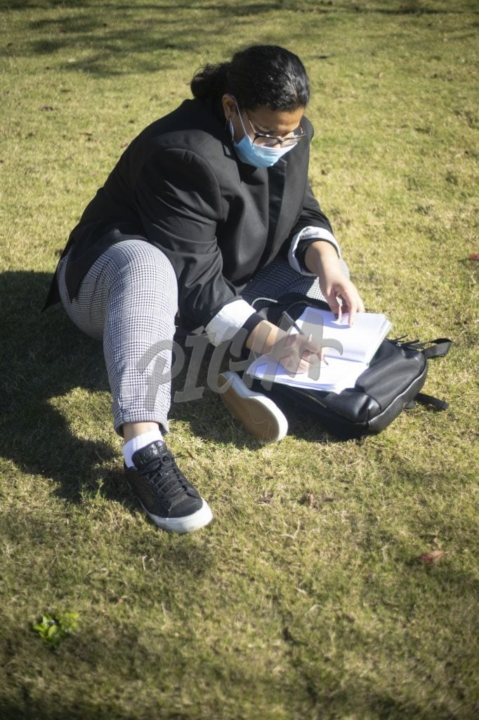 College Student studying park during COVID 19 Pandemic