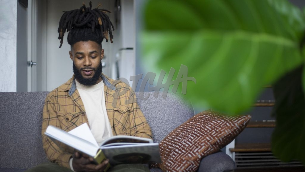 Young Black Man Reading Book