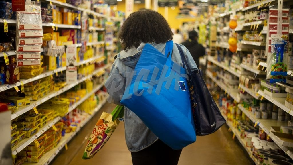 Young Woman Grocery Shopping During COVID 19 Pandemic