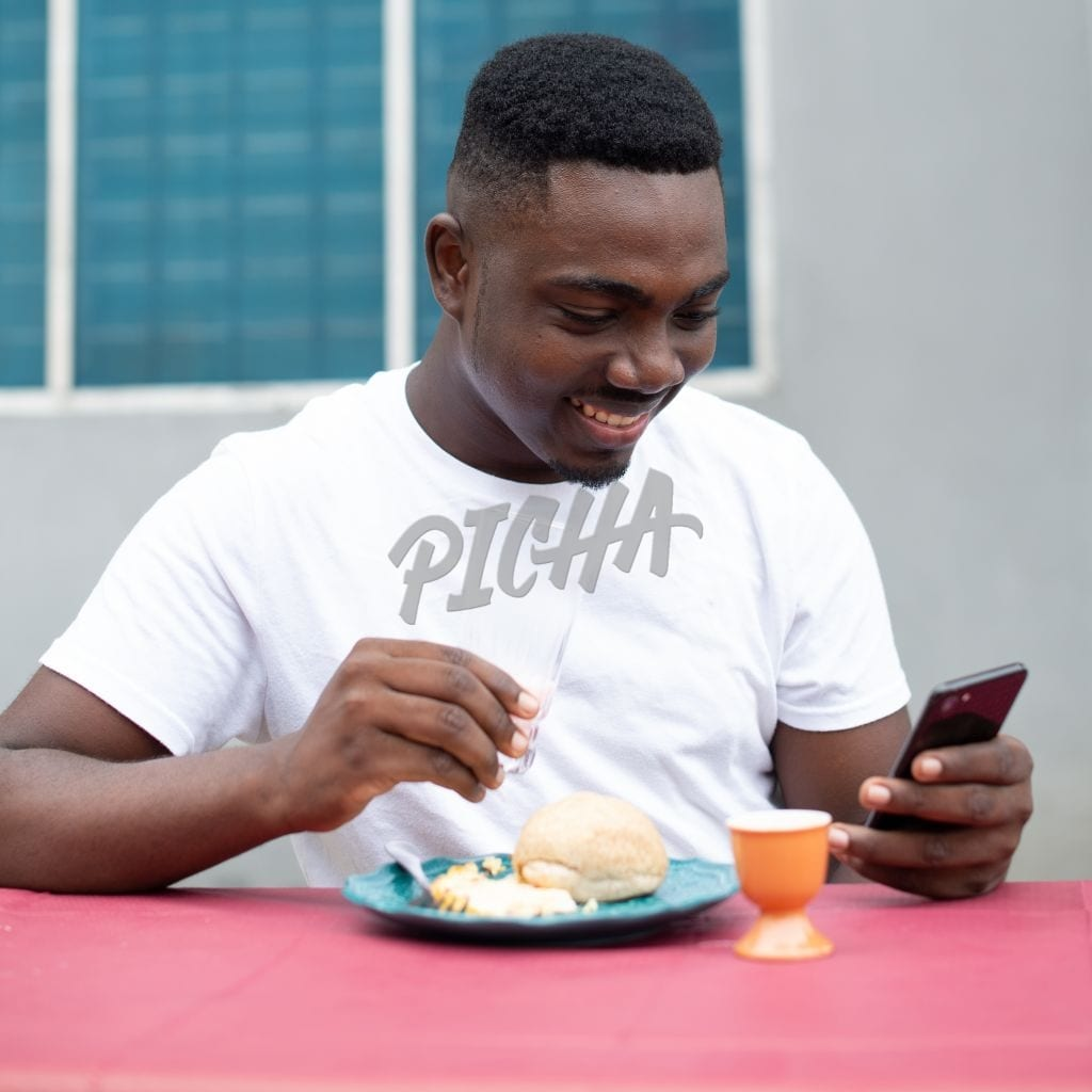 Man checking phone while having breakfast