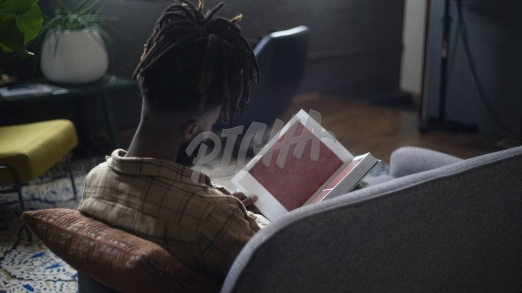 Black man reading a book