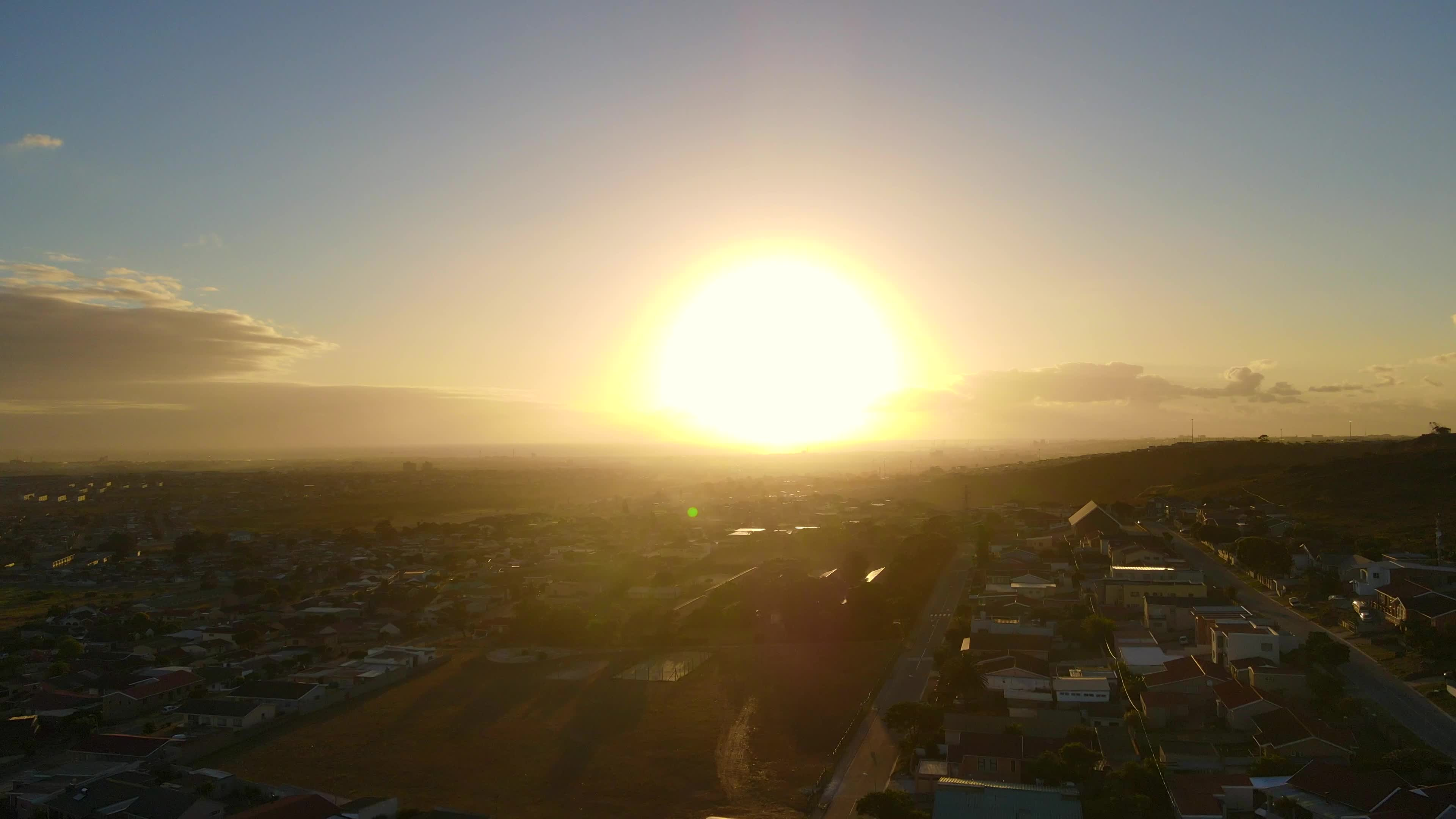 Aerial view of drone flying towards sunrise