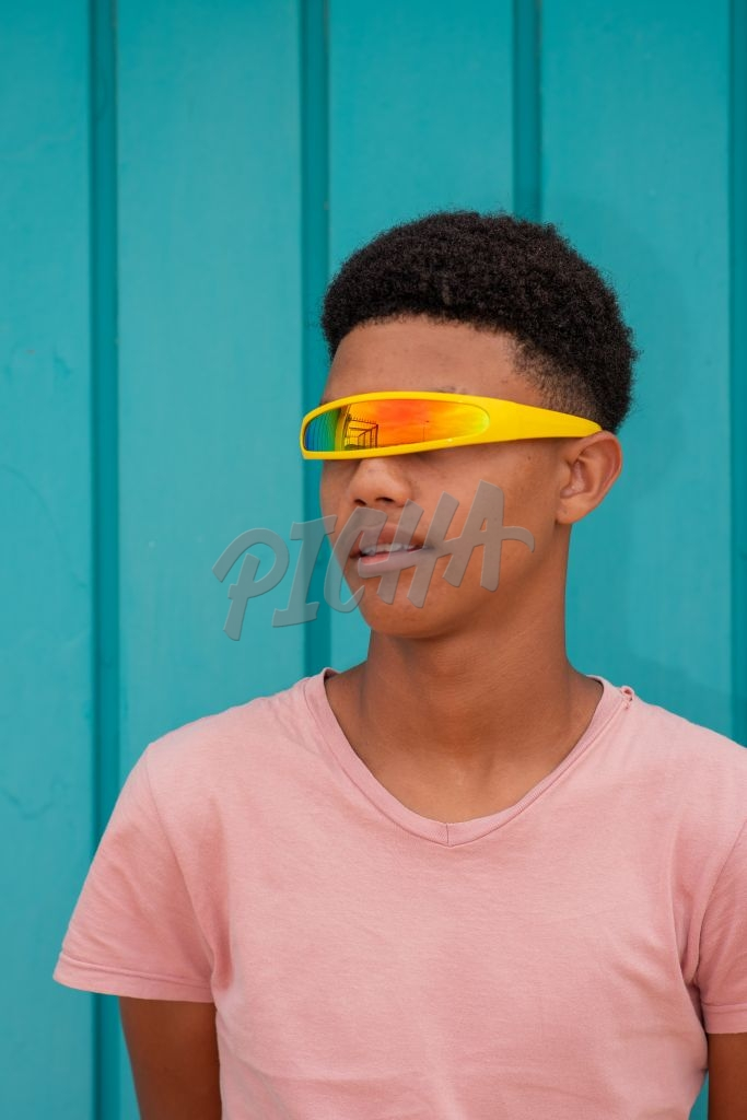 Portrait of teenager with yellow sunglasses