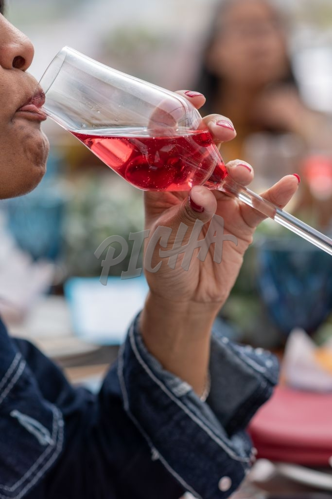 Close up shot of woman sipping on a drink