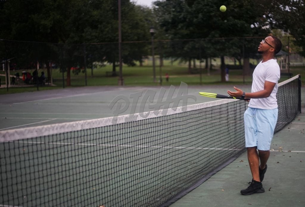 Young black man plays tennis