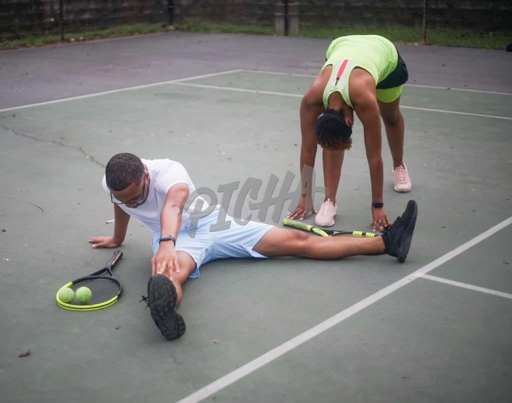 Young black couple plays tennis