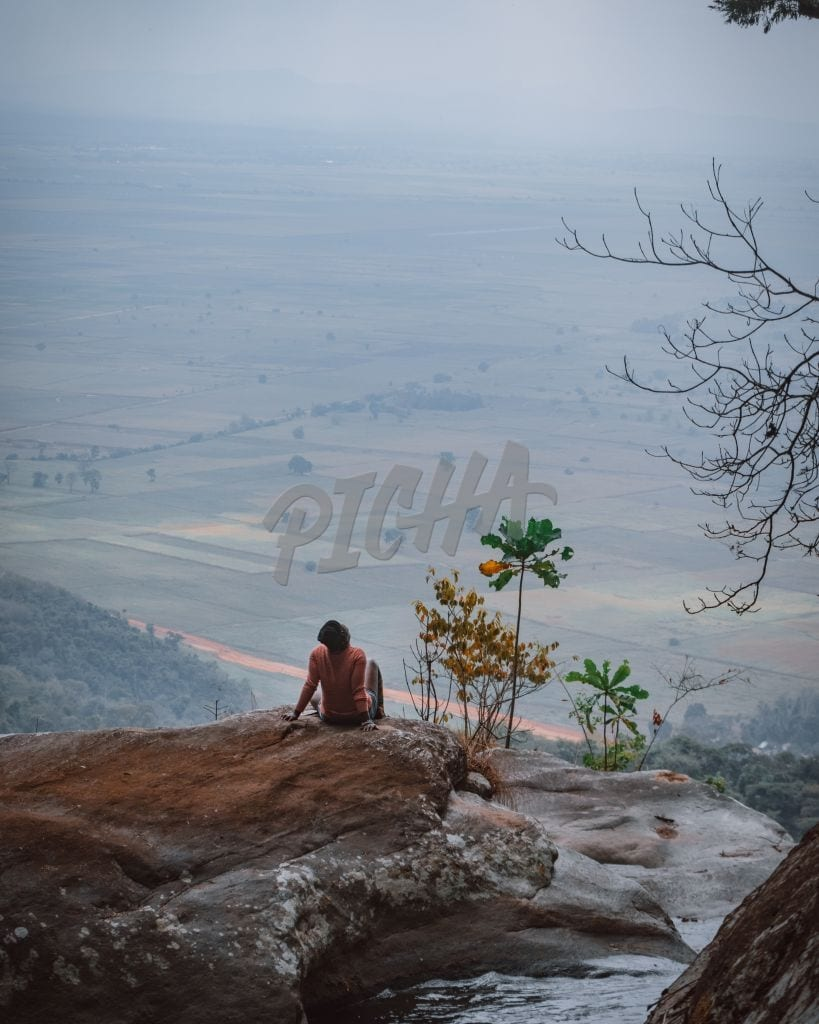 woman enjoying the view from the mountain