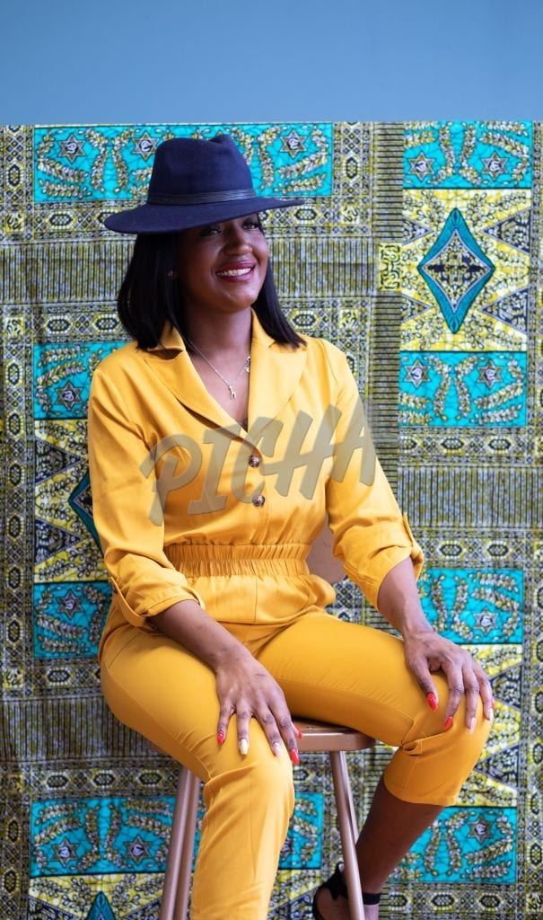Woman modelling a yellow jumpsuit