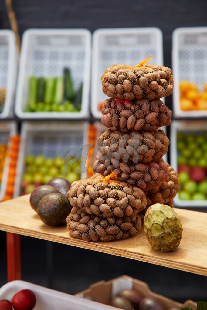 Stacks of pecan nuts at the market