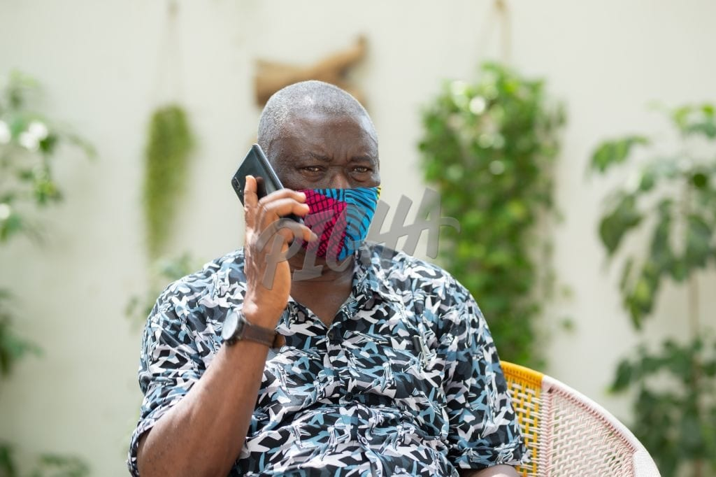 Masked man making a phone call