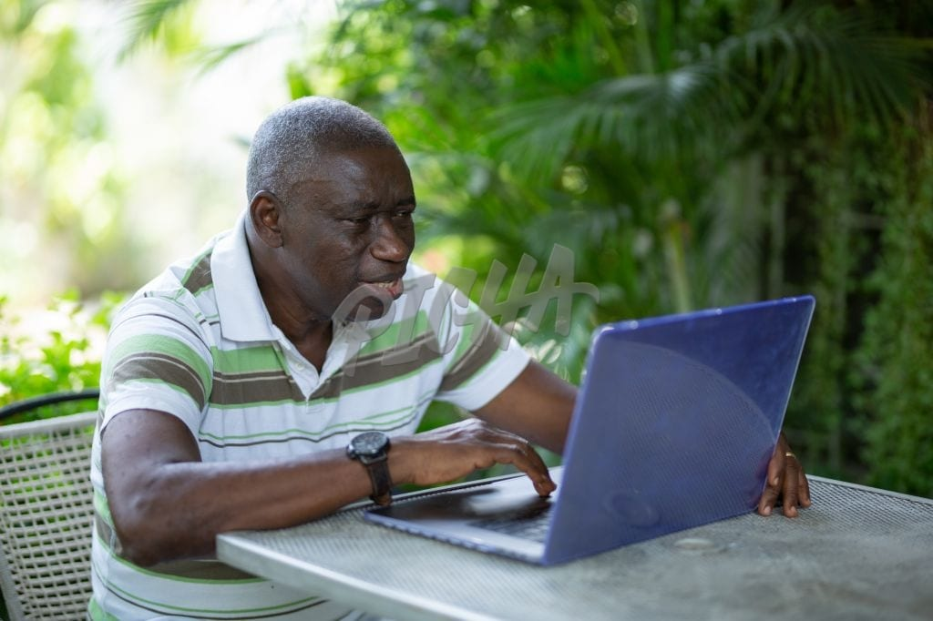 Senior man on his computer