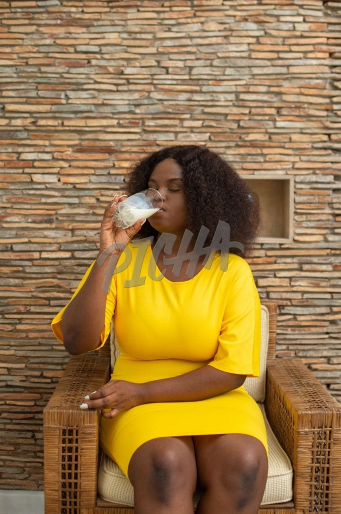 woman having a glass of milk