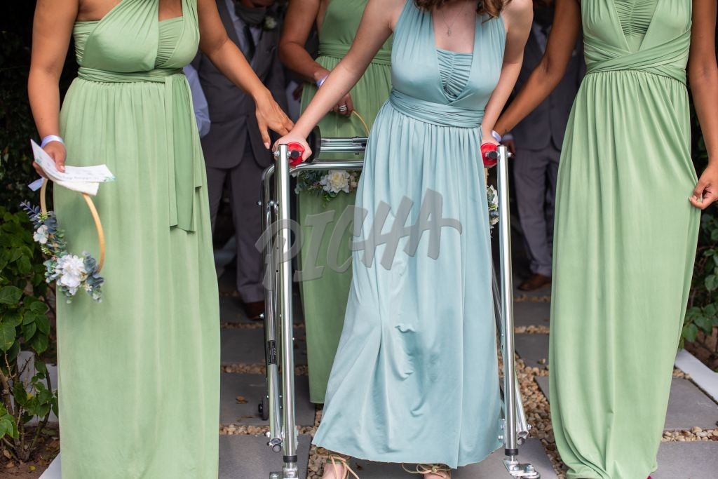 Young woman with walker participating in wedding