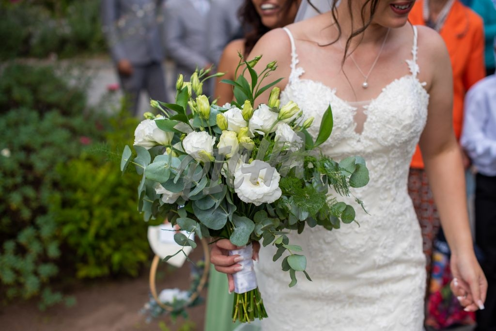 Cropped shot of bride walking with bouquet
