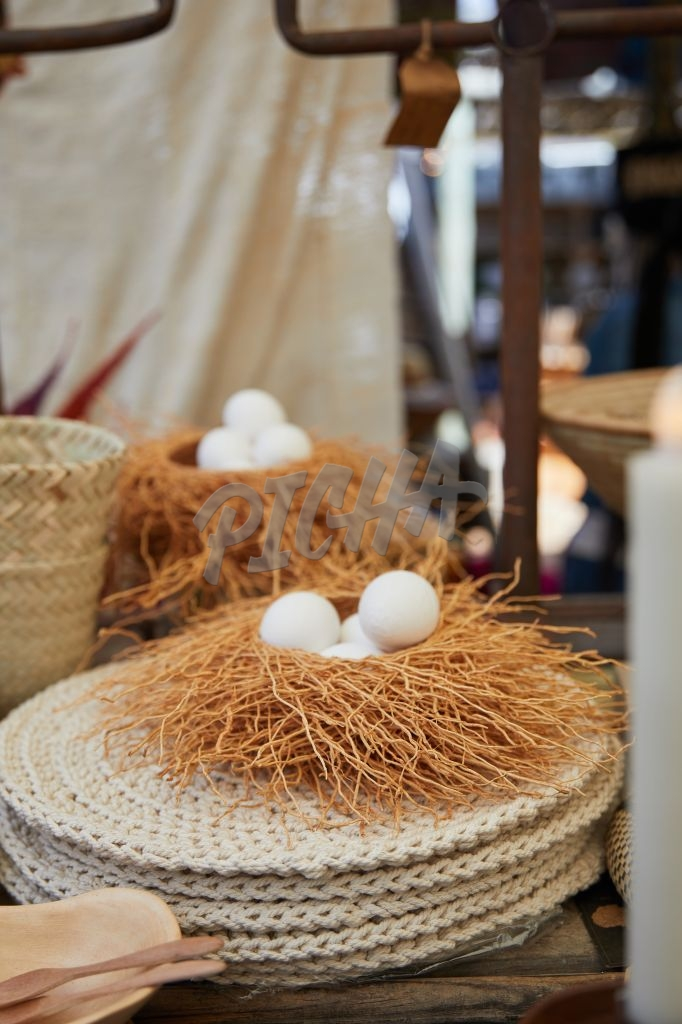 White eggs in a nest on display at a market