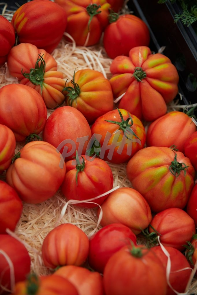 Heirloom tomatoes on sale at a market