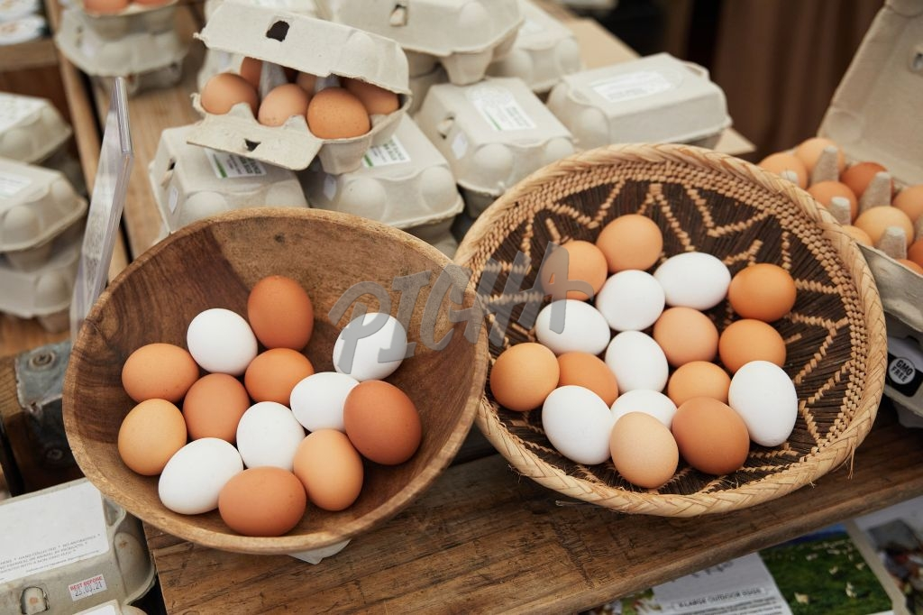 Eggs in a basket on sale at a market