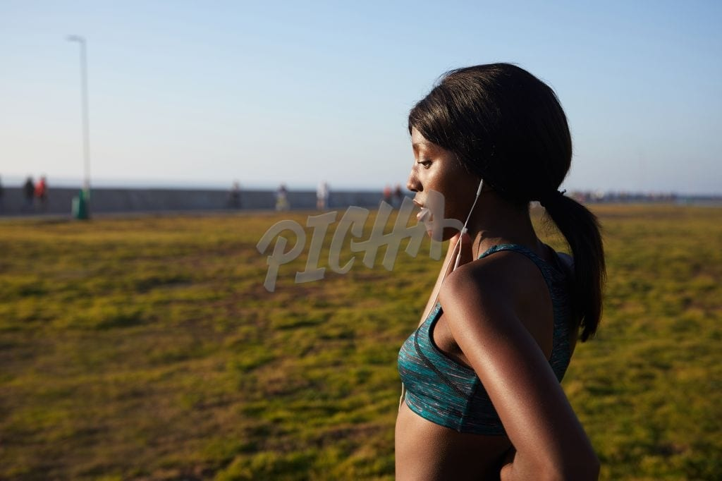 Shot of sporty young woman running outdoors