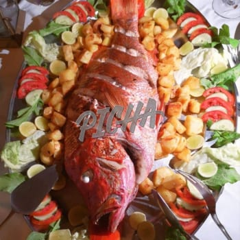 Fresh fish for dinner with tomatoes and cucumber