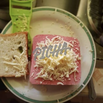 Making a ham and cheese sandwich