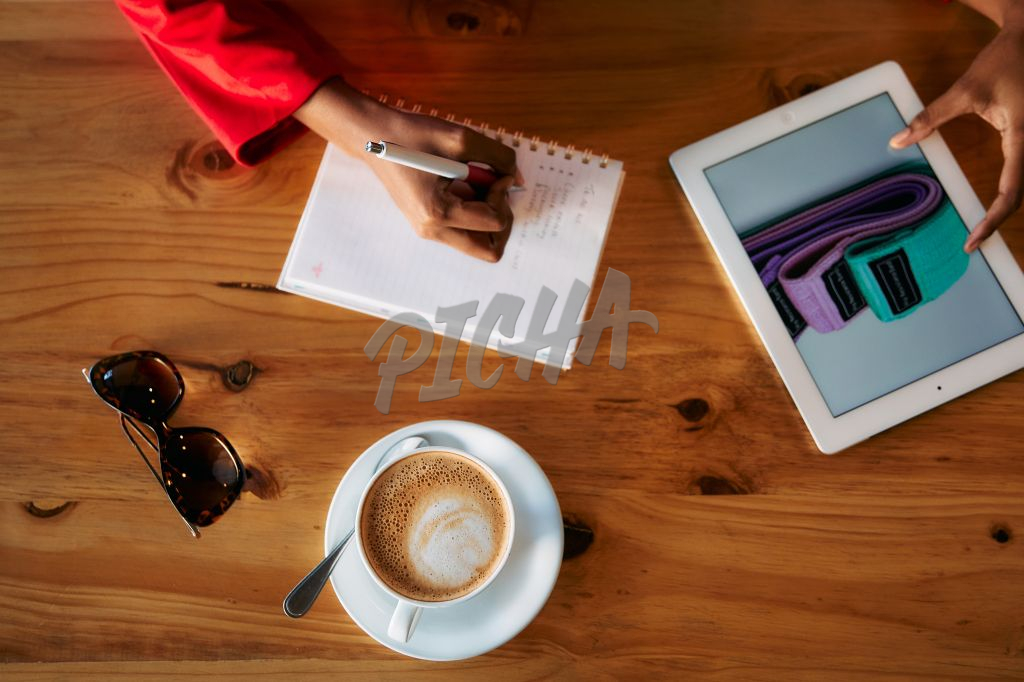 Student and young entrepreneur working at a coffee shop