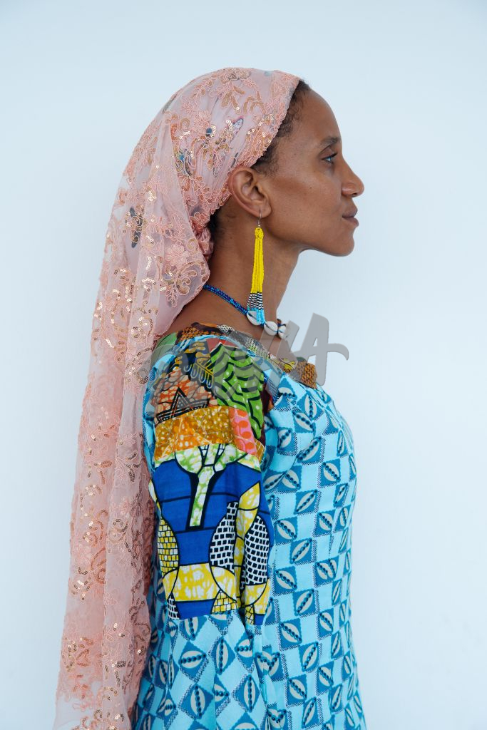 Woman dressed in kitenge and headscarf