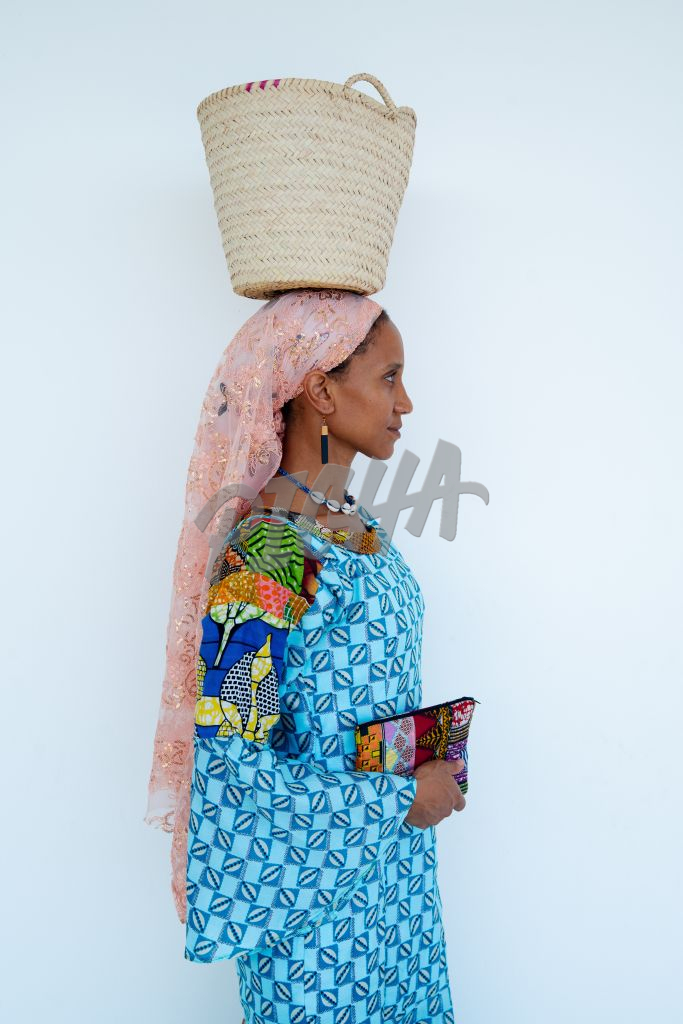Woman carrying woven basket on her head