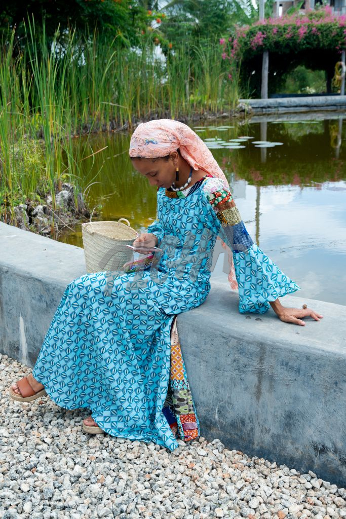 Woman uses a cellphone by a pond
