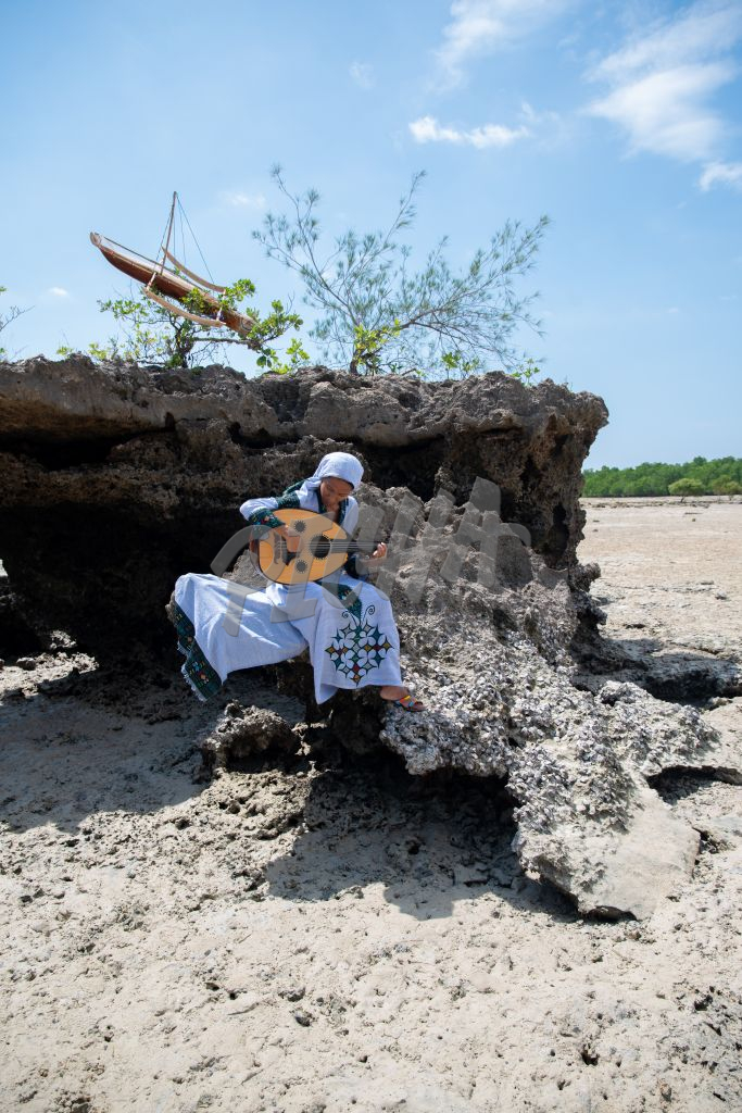 Lady playing an Oud outdoors