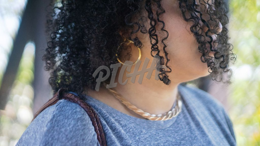 closeup portrait of a woman with curly hair