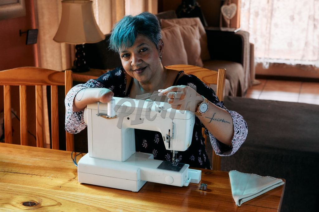 Woman working on a sewing machine