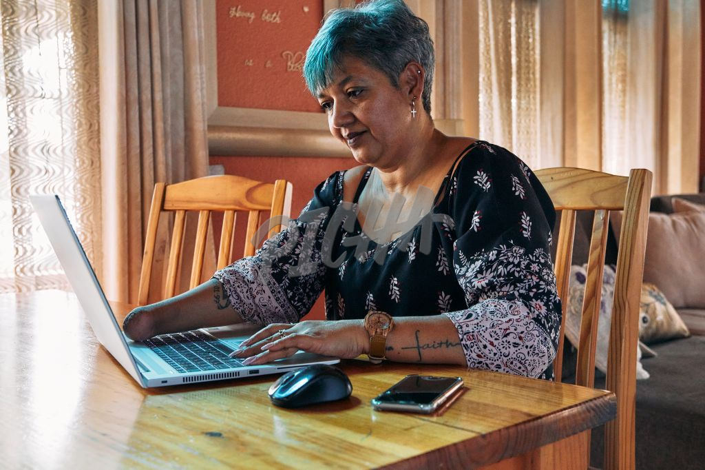 Business woman working from home sitting at a laptop