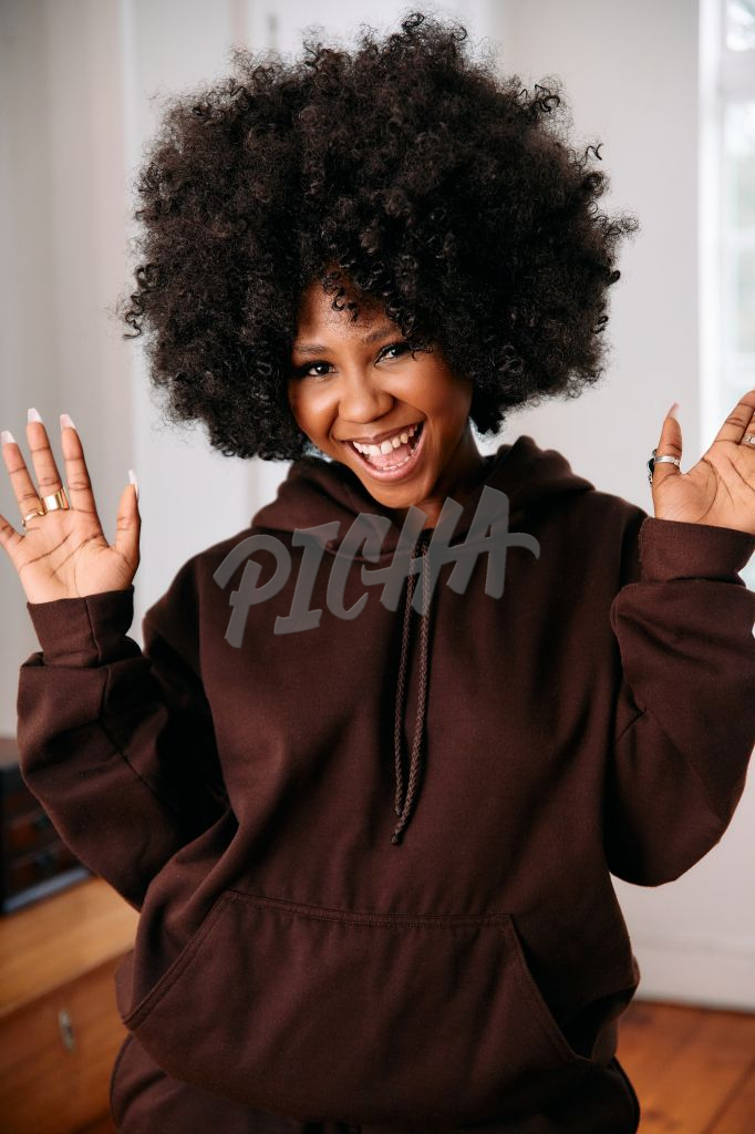 Portrait of an ecstatic woman with an afro