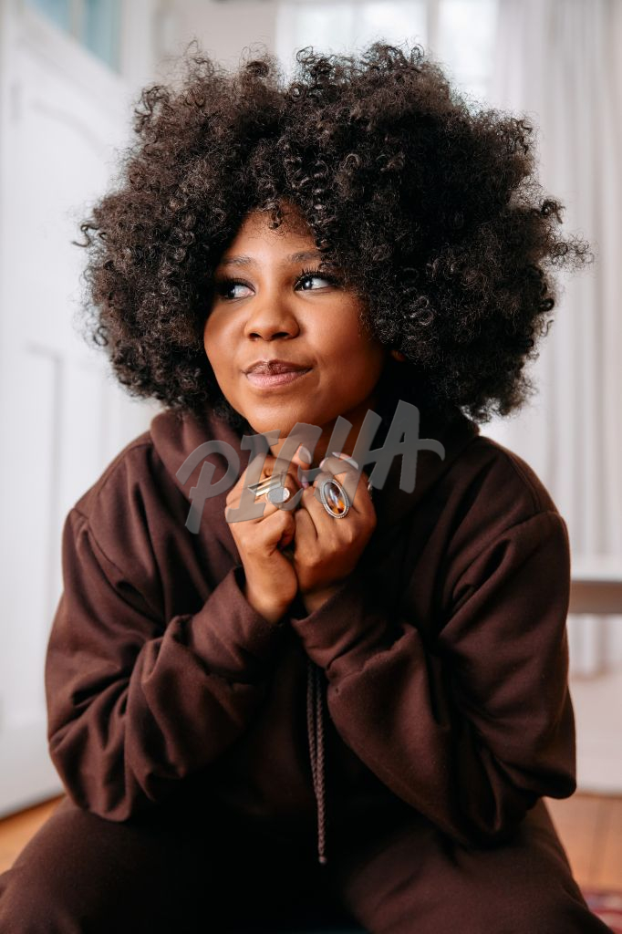 Portrait of a woman with an afro looking away from the camera