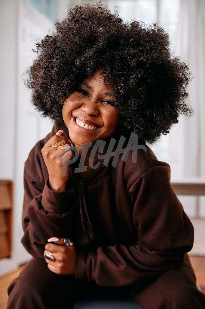 Portrait of a happy woman with an afro really happy