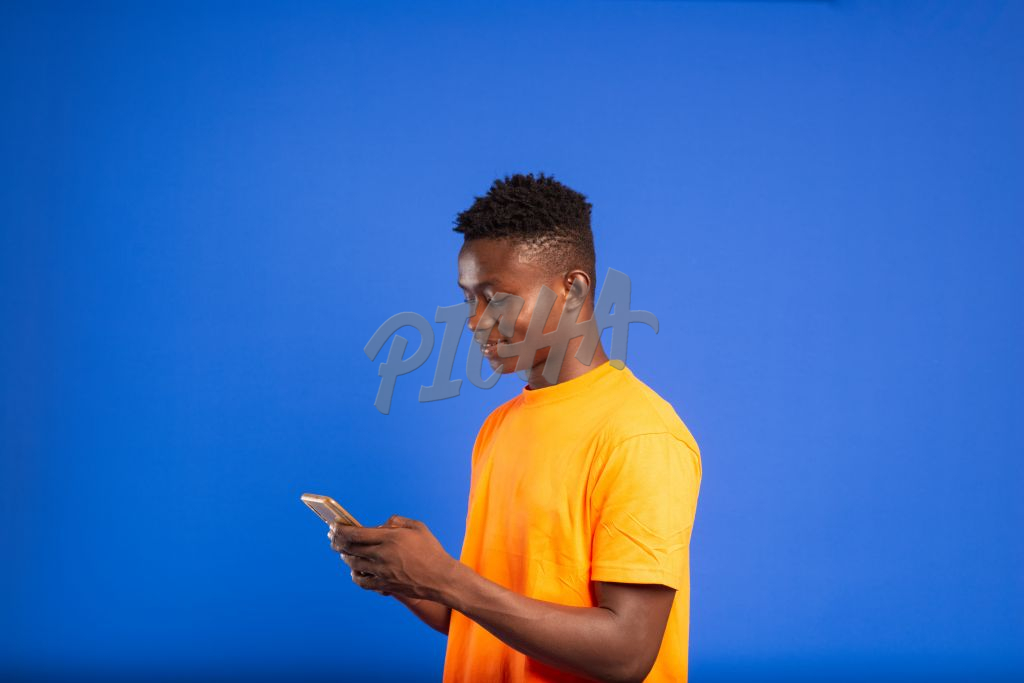Young man receiving mobile money