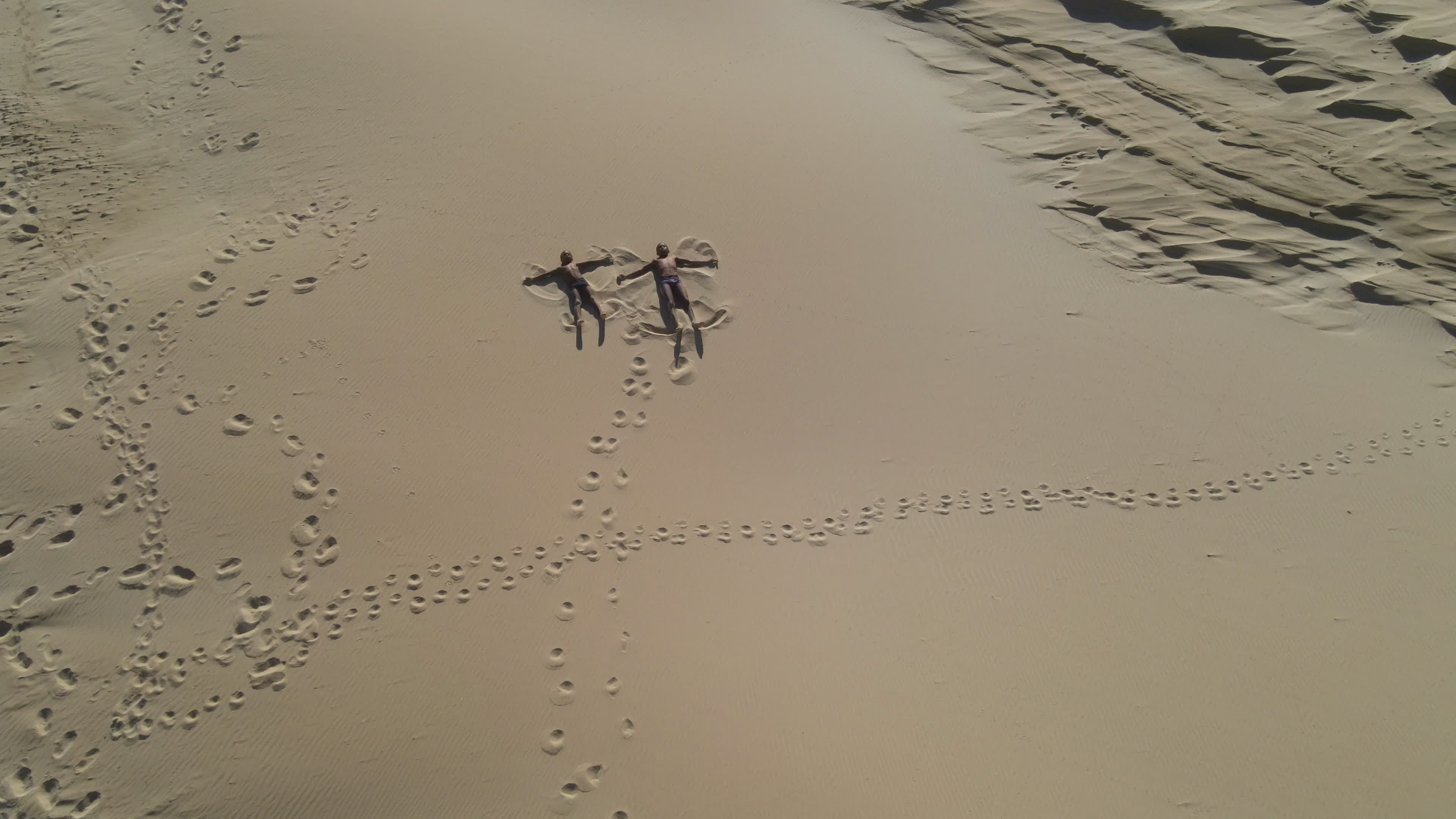 Aerial view of kids playing in sand