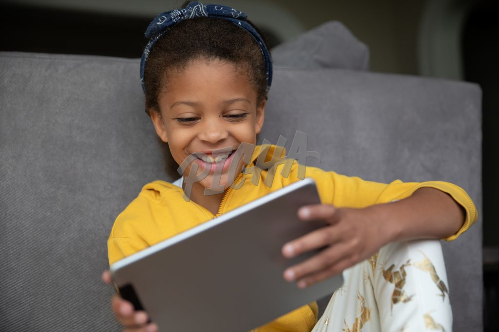 girl playing games online on a tablet