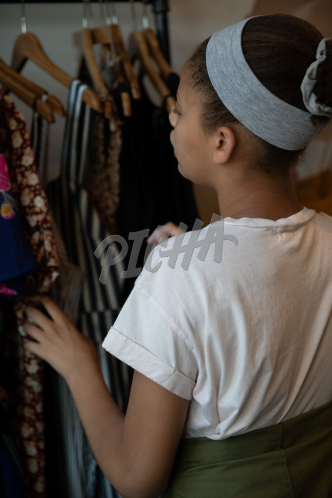 Teenage girl shopping in a store