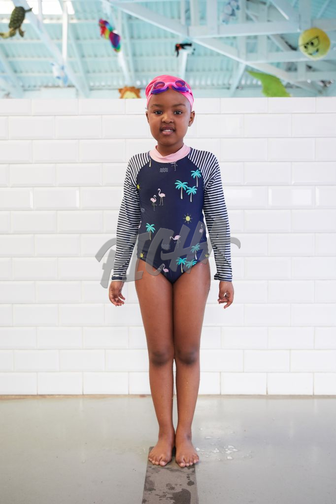 young girl getting ready to swim