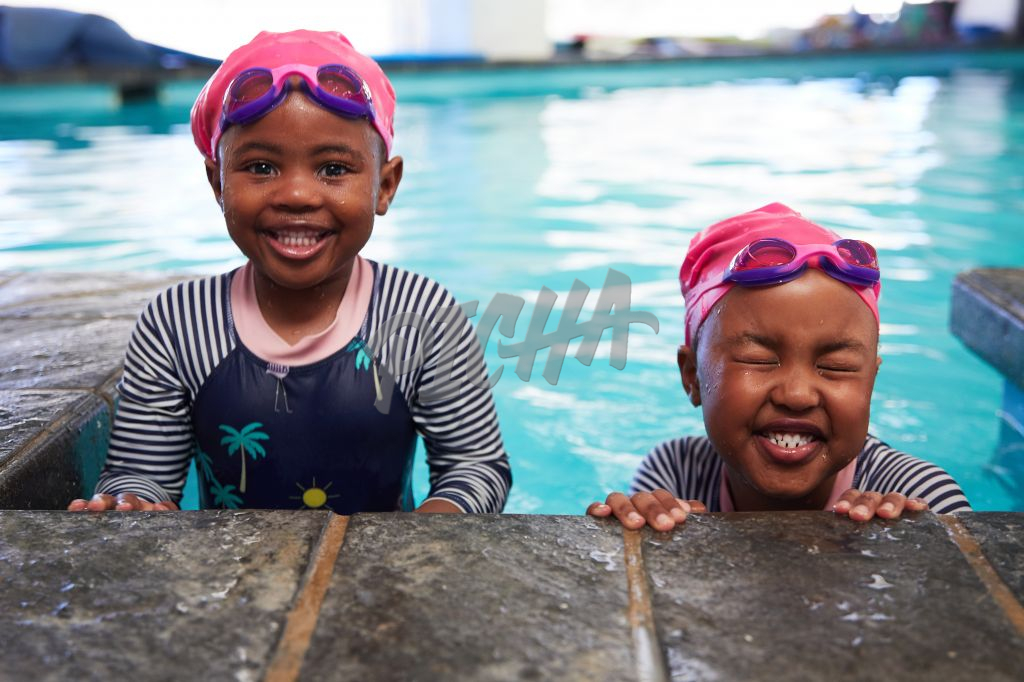 two young girls at the pool