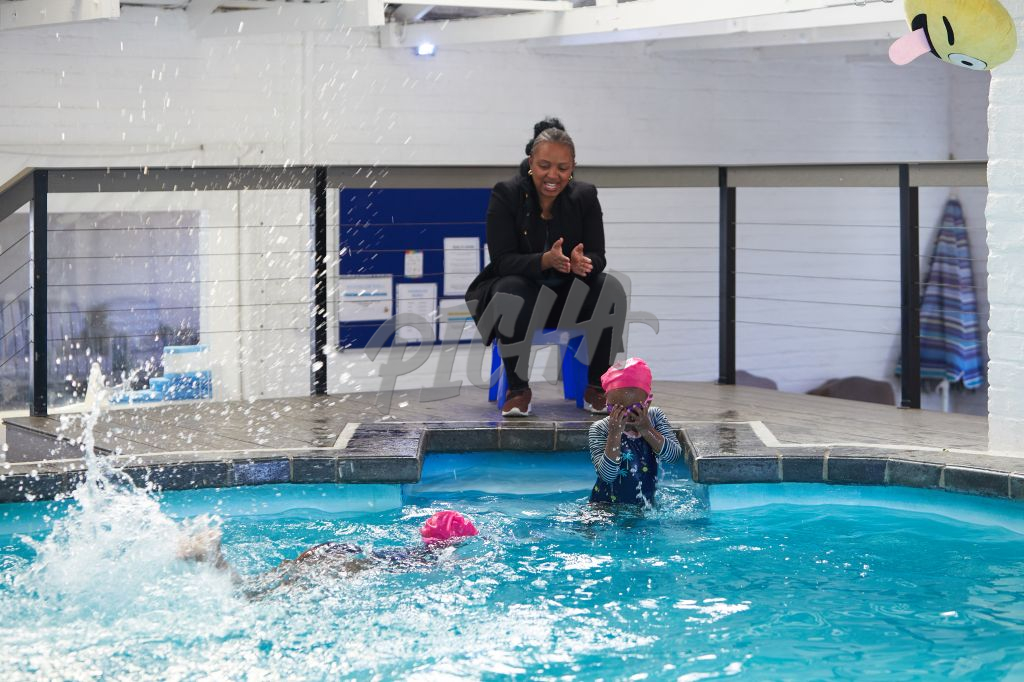 young girls taking swimming lessons