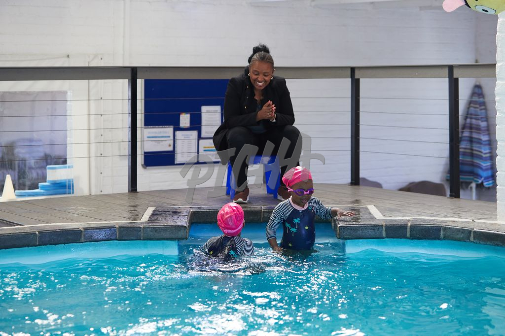 young girls learning to swim